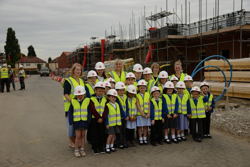Strata showing the children from Osmaston School around the site
